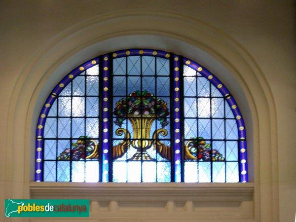 El Mercat, vitrall damunt d'una de les portes
