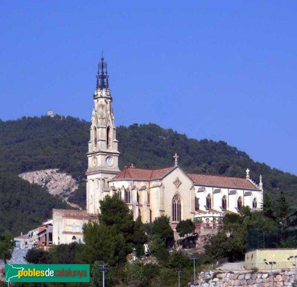 Església de Sant Esteve, vista des de la carretera de Terrassa, amb el Puig de la Creu al fons