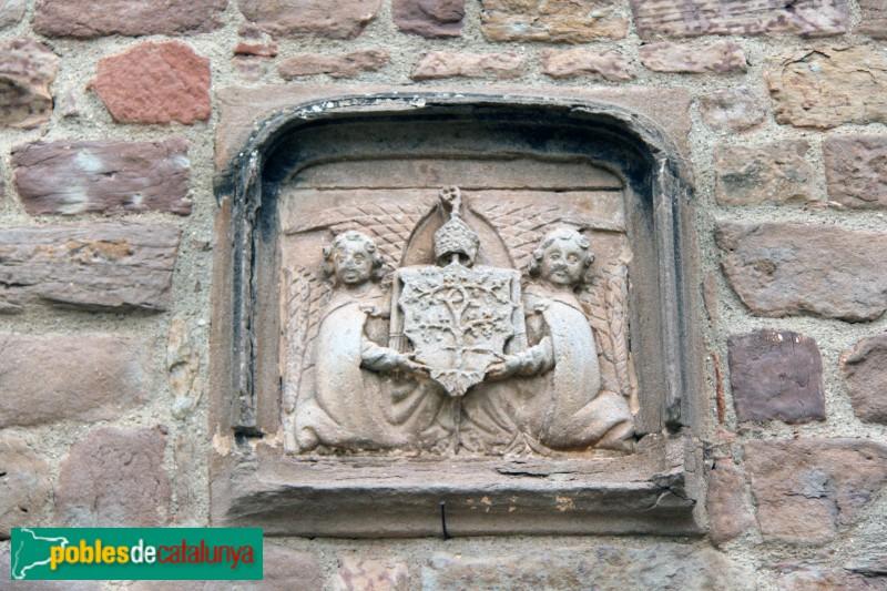 L'Estany - Monestir, escut de l'abat Rovira